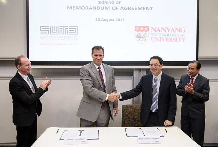Nanyang Technological University's Associate Provost for Graduate Education Professor Yue Chee Yoon (R) and Singapore University of Technology and Design's (SUTD) Associate Provost for Research Professor Martin Dunn